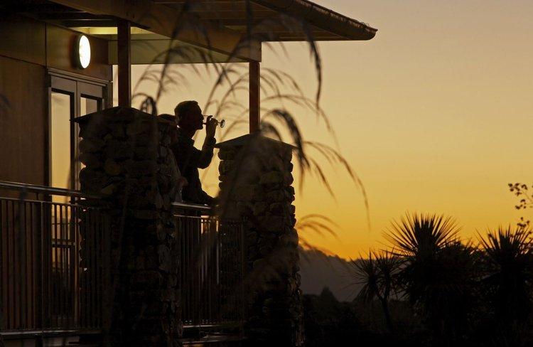 Distinction Hotel Fox Glacier - sunset wine