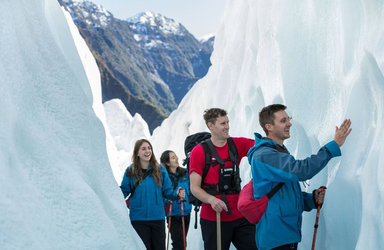 Franz Josef Glacier Guides touching ice