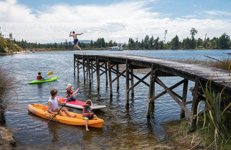 Children playing at Lake Brunner