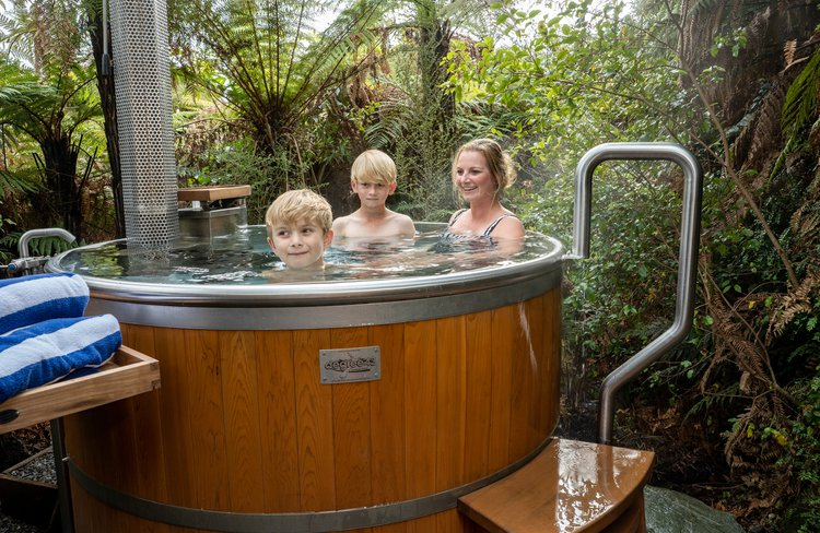 Exploring the glaciers? Stay & Soak in Franz Josef with the family.