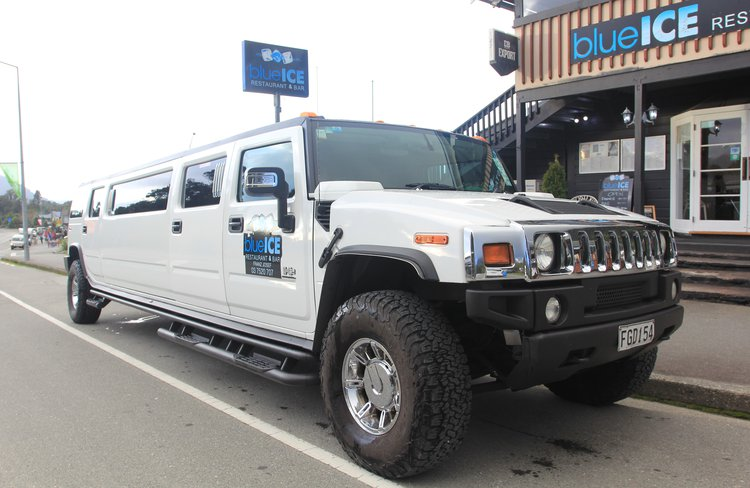 The stretch hummer seating 10-12 people, outside Blue Ice Restaurant.