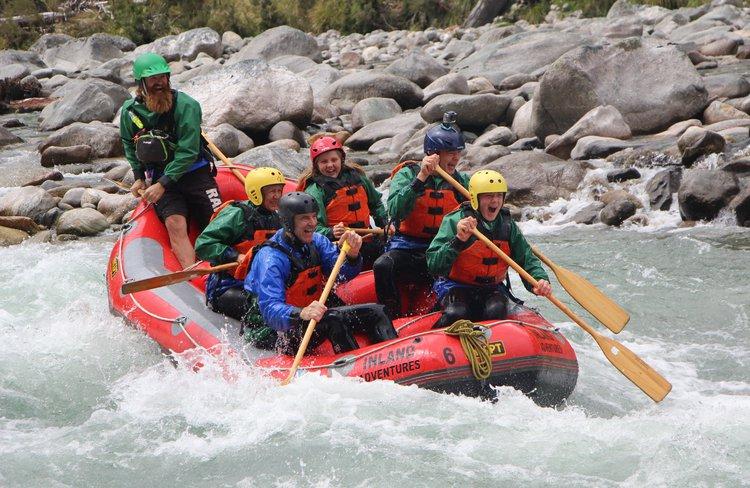 Having fun on the rapids of the Grey River/Māwheranui.