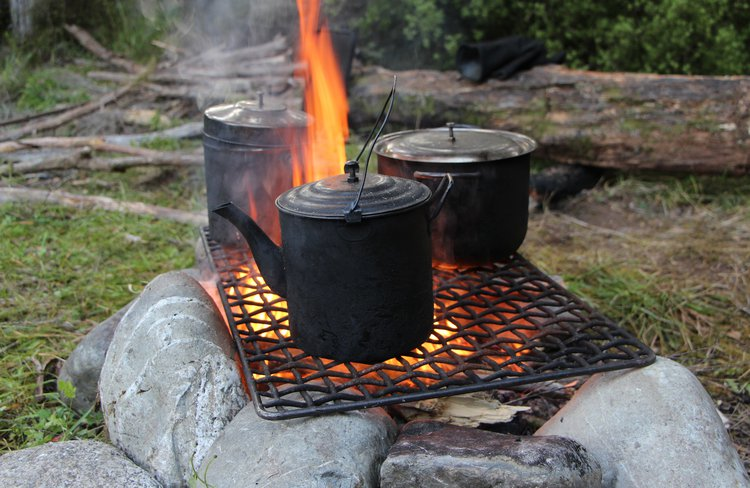Real camping experience cooking on the open flame.