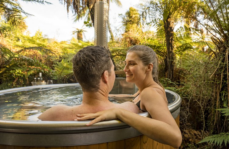 Waiho Hot Tub Experience, Franz Josef Glacier.  Fresh Mountain Stream Water, wood fire, private. Enjoy our private hot tub set in a lush rainforest setting.