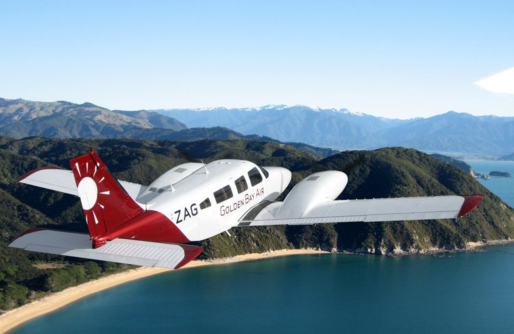 Golden Bay Air passing Abel Tasman National Park on its scheduled flight between Wellington and Takaka.