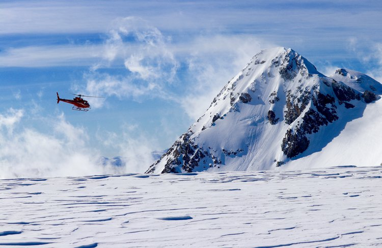 Precision Helicopters Hokitika above snow fields and glaciers in the Southern Alps.