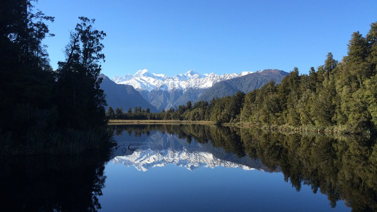 Iconic mirror-like reflections at Lake Matheson, West Coast NZ