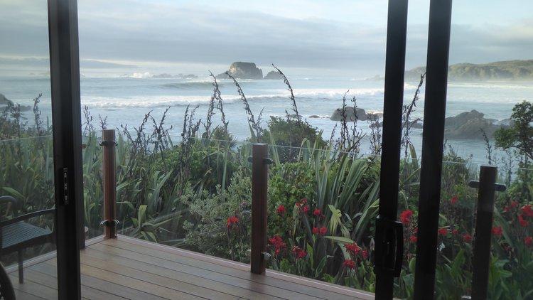 View of the breaking waves at Tauranga Bay from Beach Studio 1