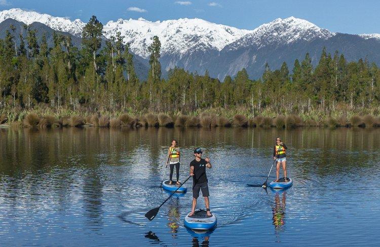 Stand-up Paddleboard on Lake Mapourika.