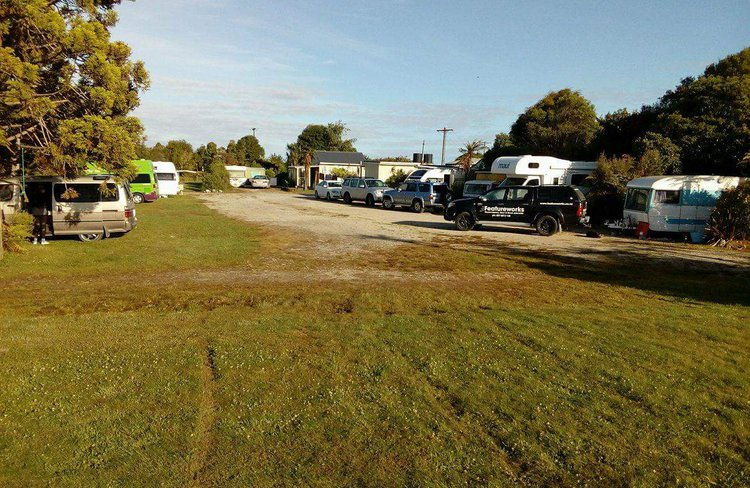 Spacious camp ground with plenty of room for campervans and tents